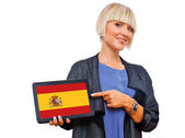 Attractive blond woman holding tablet with spain flag — Stock Photo