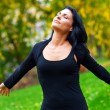 Attractive woman breathing outside — Stock Photo