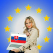 Woman holding laptop with slovakia flag — Photo