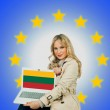 Woman holding laptop with lithuanian flag — Stock Photo #34826721