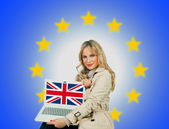 Woman holding laptop with united kingdom flag — Stock Photo