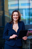 Attractive businesswoman outside — Stock Photo