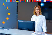 Woman at reception with european flags — Stock Photo