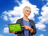 Blond woman holding tablet — Stock Photo