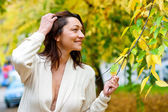 Attractive mature woman outside — Stock Photo
