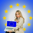 Attractive woman holding laptop with european flag on the screen — Stock Photo #34832319