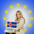 Woman holding laptop with iceland flag — Stock Photo #34833719