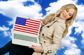 Attractive woman holding laptop with usa flag — Stock Photo