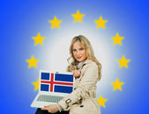 Woman holding laptop with iceland flag — Stock Photo