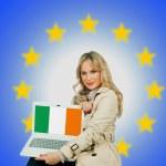 Woman holding laptop with Irish flag — Stock Photo #34842493