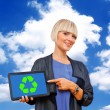 Attractive blond woman holding tablet with recycle sign — Stock Photo