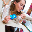 Attractive woman with tablet and credit card — Stock Photo #34849193