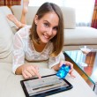 Attractive woman with tablet and credit card — Stock Photo