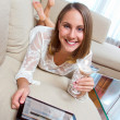 Attractive woman with tablet and drink — Stock Photo