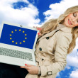 Attractive woman holding laptop with europena union flag — Stock Photo