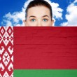 Woman face behind wall with belarus flag — Stock Photo