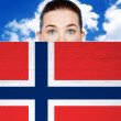 Woman face behind wall with norway flag — Stock Photo