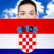 Woman face behind wall with croatian flag — Stock Photo