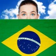 Woman face behind wall with brazil flag — Stock Photo