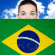 Woman face behind wall with brazil flag — Stock Photo #34901981
