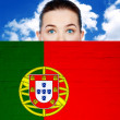 Woman face behind wall with portugal flag — Stock Photo