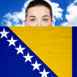 Woman face behind wall with Bosnia and Herzegovina flag — Foto Stock