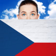 Woman face behind wall with czech republic flag — Stock Photo #34902941