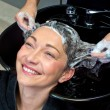 Mature woman washing hair — Stock Photo