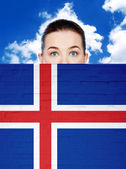 Woman face behind wall with iceland flag — Stock Photo