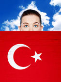 Woman face behind wall with turkey flag — Stock Photo
