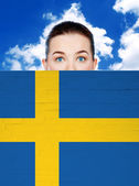 Woman face behind wall with sweden flag — Stock Photo