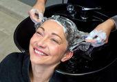 Mature woman washing hair — Stock Photo