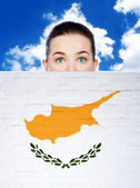 Woman face behind wall with cyprus flag — Stock Photo