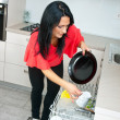Attractive woman using dishwasher — Stock Photo