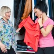 Two woman friends choosing clothes — Stock Photo