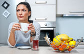 Attractive woman drinking coffee in the kitchen — Stock Photo