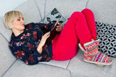 Attractive woman using tablet in the sofa at hoime — Stock Photo