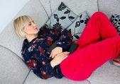 Attractive woman napping at the sofa — Stock Photo