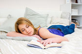 Woman sleeping with book — Stock Photo