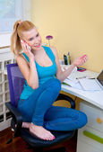 Teen girl talking to mobile phone in her room — Foto Stock