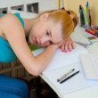 Teen girl thinking worried at her study desk — Stock Photo #45973963