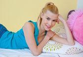 Teen girl smiling in her bed — Foto de Stock