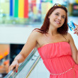 Attractive red hair woman with credit cards — Stock Photo #48886689