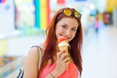 Attractive woman with ice cream — Stock Photo