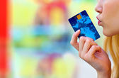 Woman hand holding credit card — Stock Photo