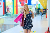 Attractive woman with shopping bags and credit cards — Stock Photo