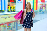Attractive woman with shopping bags and credit cards — 图库照片