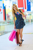 Attractive woman with shopping bags and credit cards — Stockfoto