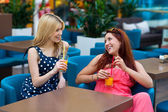 Two woman friends drinking juice in bar — Photo