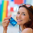 Red hair woman holding credit card — Stock Photo #48893087